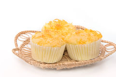 Gold egg yolk thread topped on cup cake Royalty Free Stock Photography