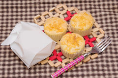 Gold egg yolk thread topped on cup cake Royalty Free Stock Photo