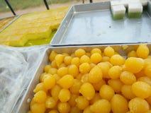 Gold egg yolks drops Stock Photo