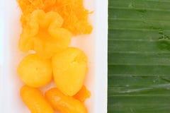 Gold egg yolks drops Royalty Free Stock Photos