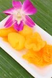 Gold egg yolks drops Royalty Free Stock Photo