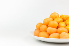 Gold egg yolks drops isolated Stock Photos