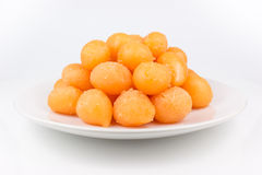 Gold egg yolks drops isolated Stock Images