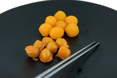Gold egg yolks drops and Pinched gold egg yolks, ancient Thai De Stock Images