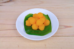 Gold egg yolks drops Royalty Free Stock Image