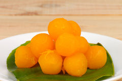 Gold egg yolks drops Royalty Free Stock Photography