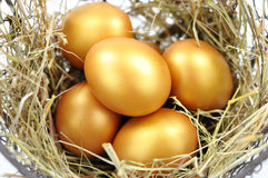 Gold eggs. Close up of gold eggs in a nest Royalty Free Stock Image