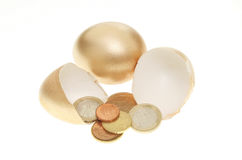 Gold eggs and Euro coins Stock Image