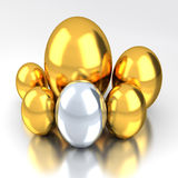 Gold Eggs. Five Gold Eggs and one silver egg with white bg Stock Photo