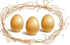 Gold eggs in the nest frame Stock Photo