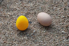 Gold Eggs on sand. Royalty Free Stock Photography