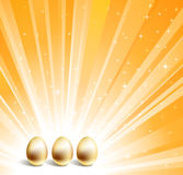 Gold eggs and yellow background Royalty Free Stock Photos