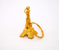 Gold eiffel tower trinket Stock Images