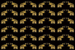 Gold Elephants on Black Seamless Background Royalty Free Stock Photos