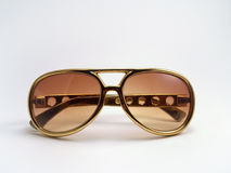 Gold Elvis Presley Sunglasses. Golden shades in Elvis style Royalty Free Stock Photography