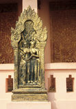Gold Emboss hanging in front of Wat Phnom Royalty Free Stock Image