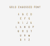 Gold embossed alphabet isolated, 3d illustration. Golden typing font design. Beveled symbols embossing on plastic card. Hammering chamfer type bar letters text Royalty Free Stock Photo
