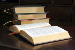 Gold Embossed Books on Wooden Desktop. This is an image of gold embossed books on a wooden desktop stock image