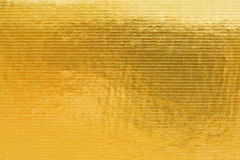Gold embossing of cardboard Royalty Free Stock Image
