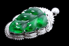Gold with emerald leaves jade crafts Stock Image