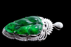 Gold with emerald leaves jade crafts Royalty Free Stock Photo