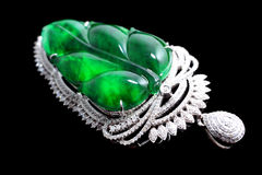 Gold with emerald leaves jade crafts Royalty Free Stock Images