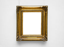 Gold empty frame on white wall Stock Photography
