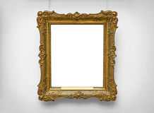 Gold empty frame on white wall Stock Image