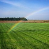 Gold at end of rainbow royalty free stock photography