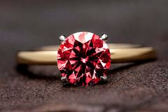 Ruby Ring. Gold engagement ring with big carat ruby gemstone royalty free stock images