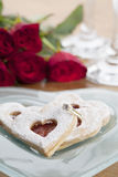 Gold engagement ring and shortbread hearts Stock Images