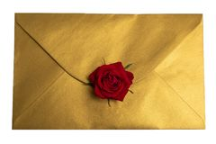 Gold envelope with red rose,top wiew, isolate in white background stock images