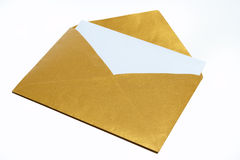 Gold envelope. White a white sheet of paper inside isolated on white background Stock Photography