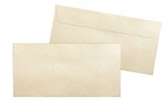 Gold envelopes isolated on white background. Decorative gold envelopes E65 format isolated on white background royalty free stock photos