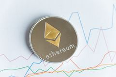 Gold ethereum cryptocurrency coin on rising line graph trading c stock photos