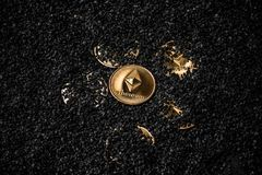 Gold etherium coin. Gold ethereum coin on black background royalty free stock image
