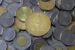 Etherium Coin on Money. A gold Etherium Token on Canadian Coins stock images