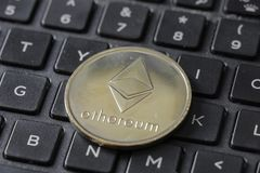 Gold Etherium Token On Keyboard.  royalty free stock photography