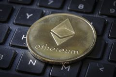 Gold Etherium Token on Keyboard.  stock photography