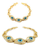 Gold evil eye bracelet. Display of two perspectives of a gold evil eye bracelet isolated on white Royalty Free Stock Photography