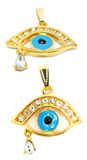 Gold evil eye pendant with teardrop stock photography