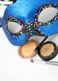 Gold eyeshadows and mask. Gold eyeshadows with brush and blue carnival mask Stock Photos