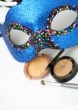 Gold eyeshadows and mask Stock Photos