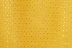 Gold fabric with diamond shapes Stock Photos