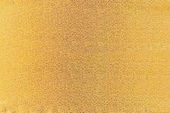 Gold fabric texture. Gold texture fabric Christmas gloss Stock Photo