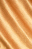 Gold  fabric texture. The grunge gold  fabric textured striped background Stock Photo
