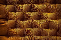 Gold fabric texture with button detail Stock Images