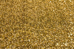 Gold fabric texture. With sequins Royalty Free Stock Photo