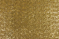 Gold fabric texture. With sequins Stock Photo