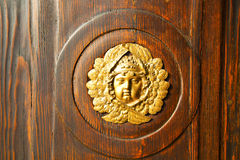 Gold face house door in italy lombardy Royalty Free Stock Photo